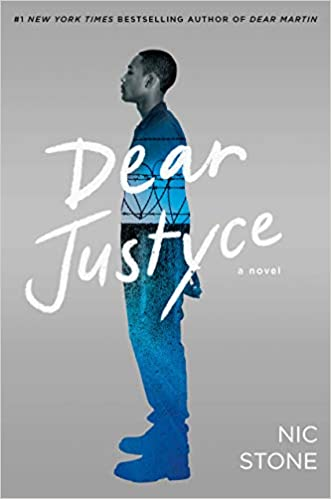 Book cover of Dear Justyce by Nic Stone. With a grey background, an older teenage or early 20s black man is standing in profile. On his clothes, you can see a blue heugh of the background - you can make out what seems to be a barbed wire fence of a jail.