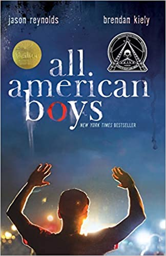 Book cover of All American Boys by Jason Reynolds. The image on the cover is of a teenage black boy from behind with his hands up at night with a light in front of his face; the viewer would assume it is in front of police, but we cannot see the police.