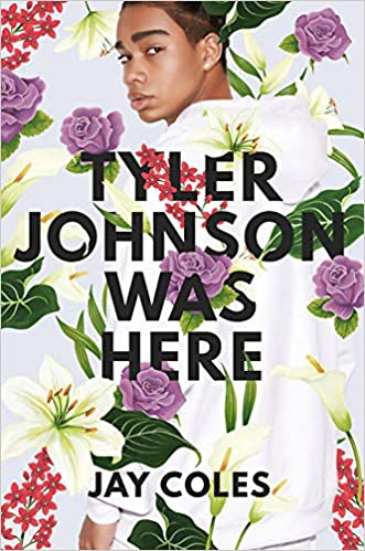 Book cover of Tyler Johnson was Here by Jay Cole. The cover features an artistic portrait of a black boy who may be just entering puberty. He is in a white hoodie. Beautiful flowers such as lilies are in front and behind him.