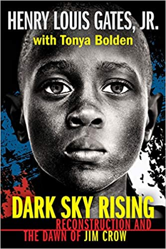 Book cover of Dark Sky Rising: Reconstruction and the Dawn of the Jim Crow by Henry Louis Gates, Jr. The cover has a sketched portrait of a pre-teen black boy with the background of black, dark blue, and a little white. The title is in Yellow and a darker red.