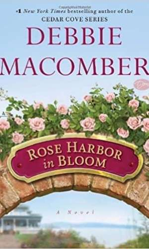 Book cover of Rose Harbor in Bloom by Debbie Macomber. Has image of an archway with roses on top with the book title in a plaque.