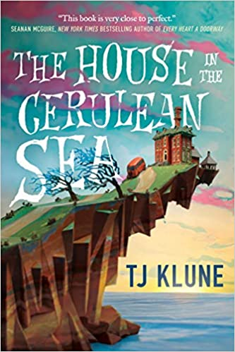 Book cover of The house in the cerulean sea by TJ Klune. The book cover features a cliff. On that cliff a large house is on the edge; it looks like the house is too heave to be on the cliff as the cliff hangs out with no support. The cover is done in a cartoon style.