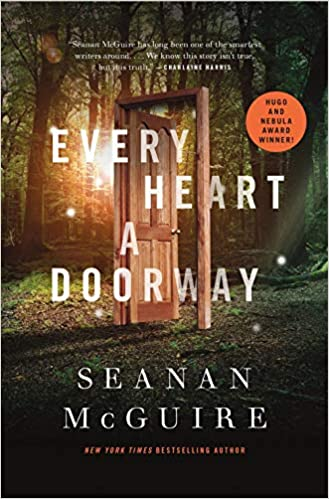 Book cover of Every Heart a Doorway by Seanan McGuire. Image of an open, wood door in the middle of a forrest.