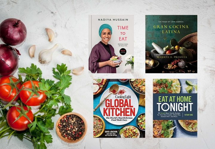 Image that has a background of a countertop with fresh garlic, tomatoes, parsley, and a bowl of peppercorns. Over the image is four books that are highlighted that are featured in the blog article.
